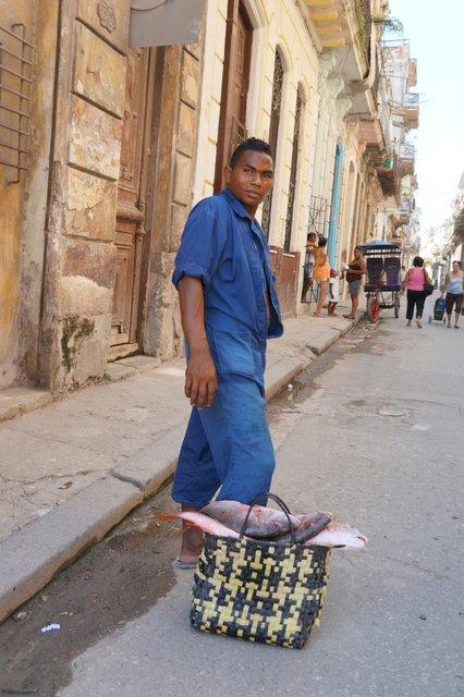 Cuban carrying fish in Havana.JPG