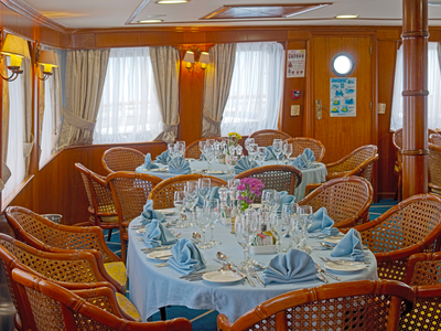 Indoor dinning room on the M/Y Callisto restaurant cruise Iceland travel restaurant relax vacation