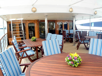 outdoor dining area Upper deck M/Y Callisto cruise yacht Iceland travel relax restaurant eat drink food