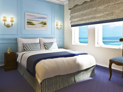 Category B cabin queen bed luxury travel M/V Victory I room Caribbean cruise vacation