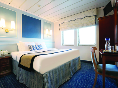 Category C cabin queen bed luxury travel M/V Victory I room Caribbean cruise vacation