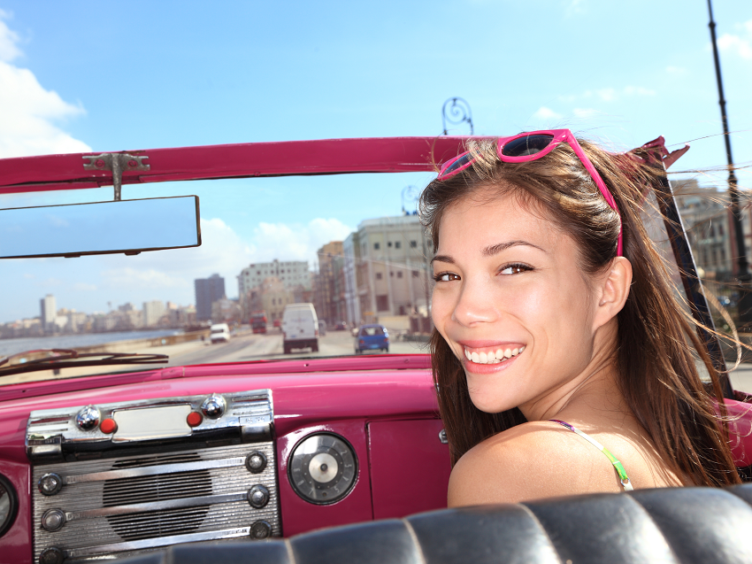 Smiling woman in classic car