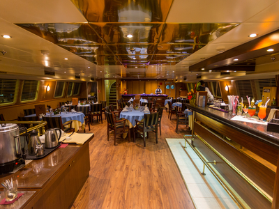 Indoor dining area m/y pegasus restaurant bar luxury yacht cruise kenya syechelles vacation