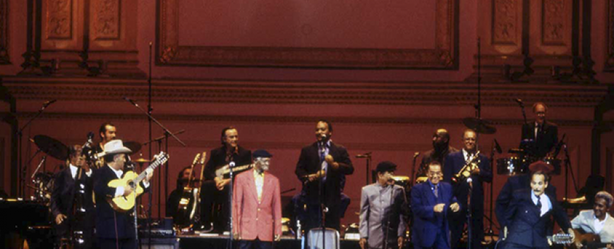 Buena Vista Social Club onstage with Barbarito playing behind back © Ebet Roberts