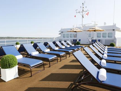 Sun deck observation deck lounge area relax chairs cruise yacht