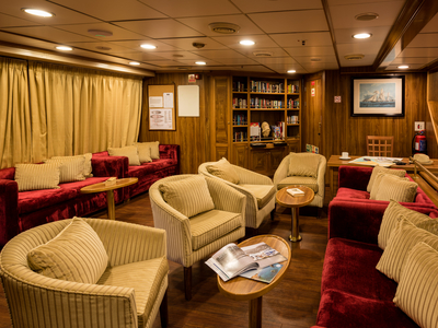 Main deck lounge area and library on the M/S Panorama relax sail sailing Cuba ship boat
