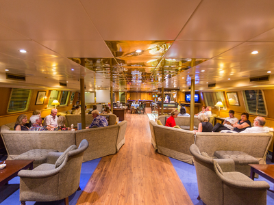 Indoor bar and lounge area aboard the M/Y Pegasus cruise seychelles dubai luxury relax drink food eat
