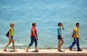 Cubans in Holguin walking down the street