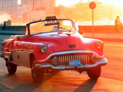 Vintage Cars Havana Cuba at sunset
