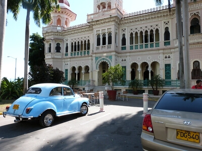 Cienfuegos Cuba building architecture travel colonial vintage car explore people to people
