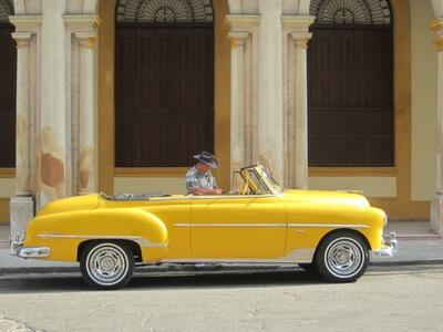Car yellow vintage cuba travel tour trip street building city Havana capital