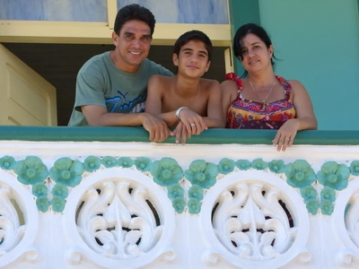 A cuban family poses for a photography in Santiago, Cuba