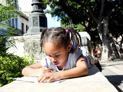 Cuban School child reads and writes language