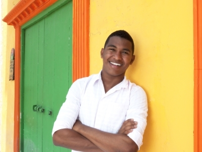 Smiling Cuban gentleman greeting Americans in Old Havana