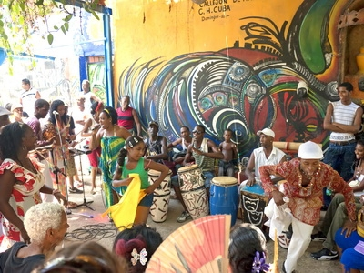 Musicians in Cuba play the drums and dance in Havana
