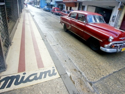 A vintage Chevrolet is seen driving the streets of Havana, Cuba