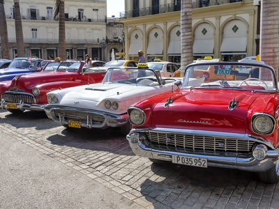 Vintage cars line the streets in Havana, Cuba