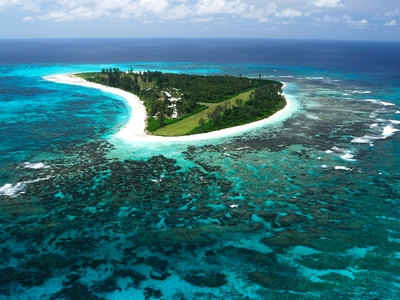 bird island Seychelles blue water white sand beach
