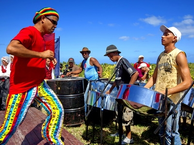 Musicians in Cuba play the drums and dance