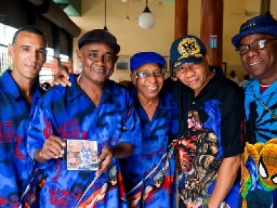 Jazz musicians pose with their CD in Cuba