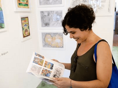 Smiling Woman in Riera Gallery