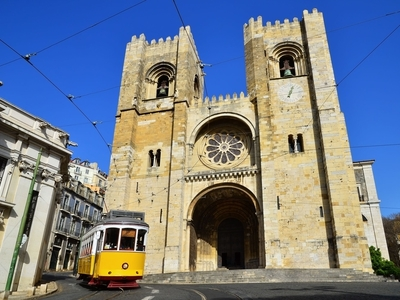Oldest Cathedral from the Xiith Century yellow tram lisbon portugal