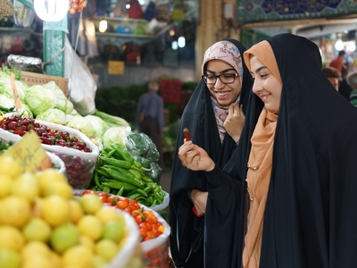 Iranian women shopping bazaar fruit market