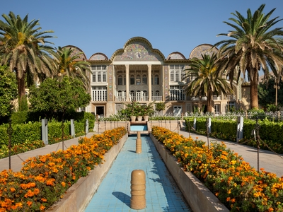 Persian garden of Eram with its beautiful pavilion, traditional Iranian fountain system and Palm trees in city of Shiraz