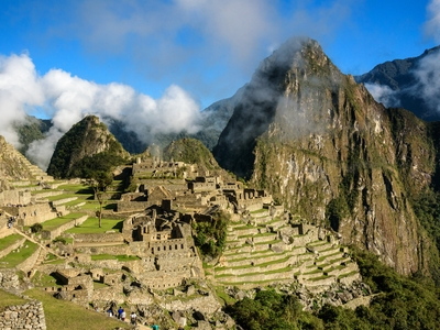 Machu Picchu clouds mountains Peru ancient Incas lost city