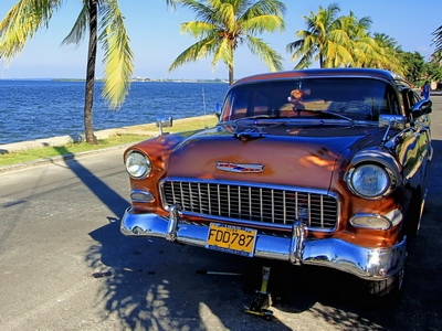 A vintage car is parked in Cienfuegos, Cuba