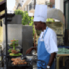 Cuban chef cooking outdoors